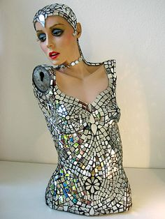 I have a vintage mannequin that belonged to my grandmother(she had a sewing factory). I'm always looking for fun ideas to do with mannequins...perhaps something like this? how neat!