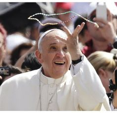 Pope Francis holds a rosary he caught in the crowd as he arrives for his weekly general audience in St. Peter's Square June 5.