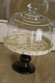 Create a cloche base with a metal lid and candlestick.