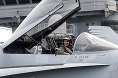 """Peter, a cancer survivor, sits inside of an F/A-18 training jet on the flight deck of the aircraft carrier USS Harry S. Truman (CVN 75). Peter, a Make-a-Wish """"Wish Kid"""", was granted the opportunity to experience the lifestyle of a Navy pilot aboard an aircraft carrier."""