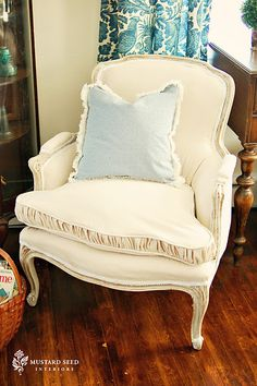 Fab chair reupholster -- the ruffled seat cushion edge is to die!