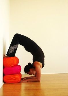 Preparation for Scorpion Pose. If you're not quite in scorpion, try at the wall with several bolsters under the feet. I love how yoga always offers baby steps! Enjoyed and repinned by yogapad.com.au