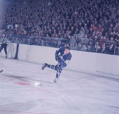 Maple Leafs center Wayne Carleton takes a slap shot during a 1967 game against the Rangers. Toronto would go onto win the Stanley Cup a few months later. Look at that crowd. Overcoats, suits, ties, and not a single jersey.