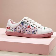 Multi Coloured 3D Flower Trim Trainers.  These pink and white 3D flower print trainers are a great new addition to your wardrobe. Wear with rolled up jeans for a great fashion forward look.