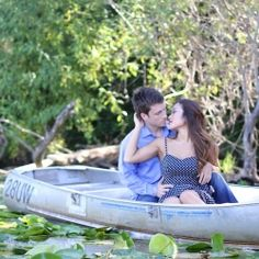 A beautiful row boat engagement shoot inspired by the 'KissThe Girl' scene from The Little Mermaid!