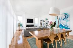 Light and airy, beautiful table and clean white walls and curtains balancing the colours in the room