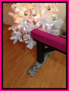 "Hot Pink Gymnastics Balance Beam with Black Base and Zebra Padded Feet 18"" Height."