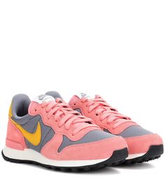 Nike - Internationalist sneakers - The iconic Nike Internationalist sneakers have been updated in an appealing colour combination of salmon pink, grey and yellow. The lightweight design features the signature suede panels and is set on a comfortable sole. We'll be wearing ours with laid-back summer basics. seen @ www.mytheresa.com