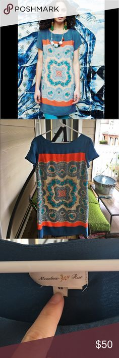 """Anthropologie """"Meadow Rue"""" SilkCalcata Tunic Dress Description •Meadow Rue for Anthropologie 'Calcada Tunic'/Dress  •Size XS  •100% Silk, (lining) 100% Poly  •Short sleeve. Pullover. Scoop neck. Falls above knee (check measurements). Body is fully lined. Hand wash/line dry.  •Beautiful silk shift from Meadow Rue. Geometric/floral print in steel blue, orange, cream,   •Measurements 35"""" long, 16"""" across bust Anthropologie Dresses"""