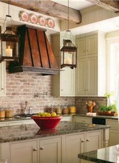 One of the most comforting European kitchens I've seen .. exposed brick, with the copper oven hood, textured countertops, wood beams