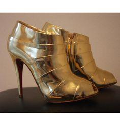 Tip: Christian Louboutin Heels (Gold)