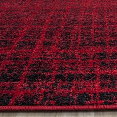 Shop the Rug - Color: Red, Black; Size: Round by Safavieh. Made from Polypropylene in Turkey. This Power Loomed Red, Black rug has a pile_height, perfect for a soft yet durable addition to your home.