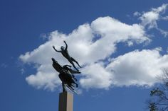 In Greek mythology, Pegasus is the flying horse of the gods, and a child of Poseidon. In one legend, the hero Bellerophon rides Pegasus.Carl Milles created his sculpture in USA for Des Moines in Iowa. The horse is endowed with powerful wings and flies at an angle toward the sky. The man has nearly detached himself from the horse and appears to fly of his own volition. It is an image of mans potential and the power of imagination as much as an illustration of the myth of Bellerophon and…