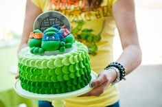 I like the side decor with varying shades of green. Ninja Turtle Cake