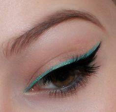Emerald and black winged eyeliner.