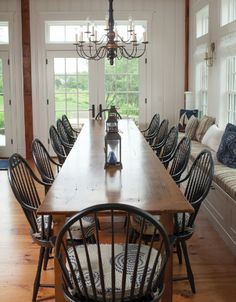 Nikie-here is an example of a table we like. We like the worn rich color of the wood. Would not have to quite this long, but we want to seat 10 hopefully.   Tim Smith (Minglewood Homes, Chatham) built the dining table from reclaimed wood.