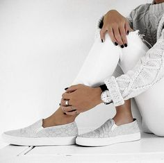 Sleek sneakers, distressed white jeans, and a cable knit sweater