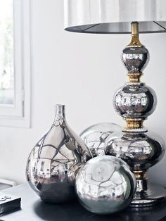 I love mirrored lamp bases. Natural light reflects off the base beautifully in the space. Also, it creates an elegant display.