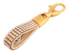 Cango & Rinaldi key ring with golden color Swarovski crystals. With this key ring you will not lose your keys into your purse.  Length 8,5 cm = 3.4 in Crystal length 4,0 cm = 1.6 in Wide 1,0 cm = 0.4 in