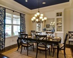 dining room with navy ceiling