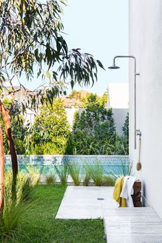 """A pool completes the lush new backyard, the frameless glass fence ensuring visibility from the house. Monsoon column shower, [Sussex](http://www.sussextaps.com.au/?utm_campaign=supplier/