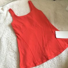 Lululemon Tank Lululemon Tank wide straight straps,tight fit stays put, customize your adjustable bra band, has sheer details see pictures. lululemon athletica Tops Tank Tops