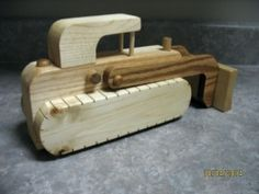 """Handmade Wooden Bulldozer - Locally handcrafted wooden Bulldozer is made from assorted hardwoods and finished with natural, non-toxic wood oil. Bulldozer has hidden wheels under the tracks! Measures 5"""" high x 9.75"""" long. Made to last, this will be a treasured toy that can be handed down for generations! - See more at: http://www.babyandbeyond.ca/product.php?productid=9290&cat=367&page=2#sthash.pZKL8KaW.dpuf"""