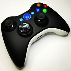 Black on White custom modded Xbox 360 controller with illuminated buttons and a white ring of light from www.intensafirestore.com. Just $99.95.