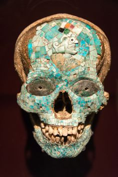 Aztec mask of Xiutecuhlti, god of fire made from a human skull and inlaid turquoise, jadeite and spiny oyster.