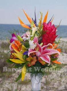 Barefoot Weddings Beach Wedding Bouquets.    love vibrant tropical flowers and colors!