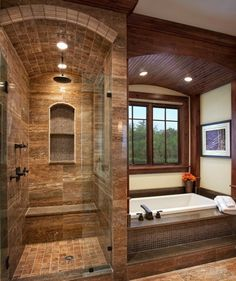 Wood and stone bathroom with a view!