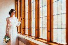 Lace wedding dress made by Pukuni (www.pukuni.fi). Long sleeves, bride, castle, Turku, Finland.