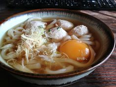 Udon with minced chicken balls and a row egg yolk...