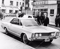 Photo candid of Sean Connery and his slick new 1963 Buick Riviera ! .....is that a Gabor Sister too ??????