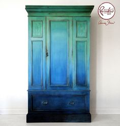 Annie Sloan's previous Painter in Residence, Ildiko Horvath used her signature ombré technique to give this wardrobe a bold new look. She started at the top with Chalk Paint® in Amsterdam Green and a little Pure, blending into a mix of Duck Egg Blue and Louis Blue. She then added Greek Blue with a mix of Pure, gradually going down into Napoleonic Blue at the bottom. The details and edges are brushed with Graphite to create a sense of depth.