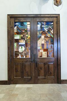 Custom Built American Black Walnut Doors with Custom Stained Glass by Soos.