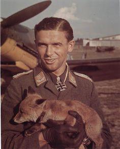 Hauptmann Hans Philipp holding baby wolf
