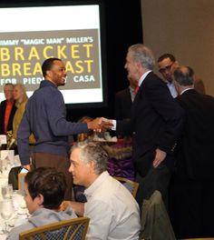 "UVA Associate Head Basketball Coach Ron Sanchez greets panelist Barry Parkhill at ""Jimmy Miller's Bracket Breakfast for Piedmont CASA"" on March 14, 2016. Image by Jennifer Byrne Photography."