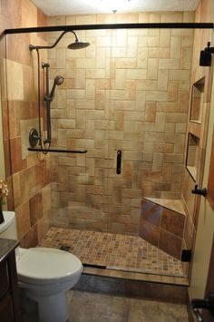 This would look so good in my bathroom!! Small Master Bath Remodel, Master bath with complete tile shower, herringbone pattern on back shower wall. Glass shower doors. Tile floor. 6 different types/colors of tile. Boulder vessel sink with marble vanity top.  All work was done by me (a DIYer) with exception of the shower door., Shower with frameless glass shower door, Bathrooms Design...