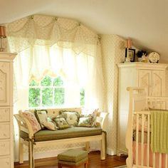 What a sweet nursery for a very special little one.  The furniture, window covering all add up to a very charming room.