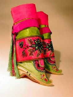Shoes from Sechuan province with braid, gilt foil, and bead decorations; lotus embroidery on toes; paired with beaded leggings and silk putt...