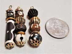 BF-297; Three Drops of Assorted  Bone and Horn Look Alike Beads That have an African Motif Accented with Gold Findings and beads Cornicello, Upcycled Crafts, Look Alike, Craft Items, Pearl White, Horns, Craft Projects, African, Drop