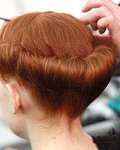 '40s-inspired hair at Carolina Herrera's fall 2013 show. | http://www.makeup.com/article/carolina-herrera-fall-2013-backstage-beauty/