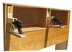 This bed headboard has hidden pistol compartments that drop down for quick access (via chadking)