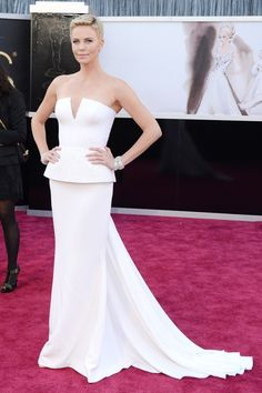 Charlize Theron accessorised her white Dior Couture gown with Harry Winston jewellery