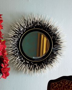 "Glass and wood. Artfully hand painted to mimic the prickly quills of a porcupine. 33""Dia. x 5""D. Imported. As seen in Real Simple Magazine. Boxed w"