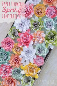 Paper Flower Spring Centerpiece. Use your Cricut Explore to create this stunning Spring Centerpiece. See the tutorial at www.thehappyscraps.com