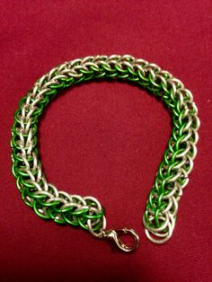 Chainmail bracelet is on AllenCreations website in green and silver.