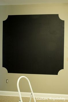 chalkboard wall painting finished. Like this a lot better than the full wall!!!