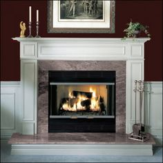 This wood burning fireplace has a granite topped hearth and surround.